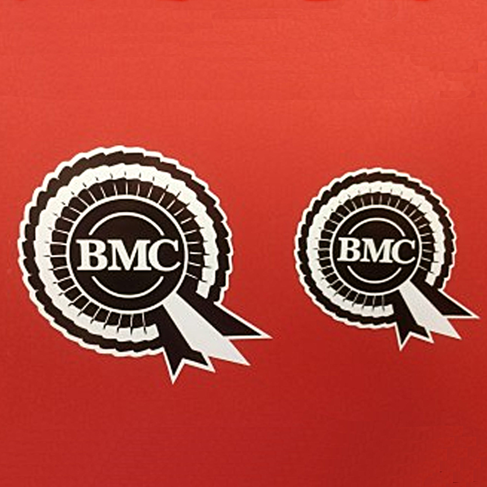 BMC in bold white lettering in the centre of a black and white BMC rosette.