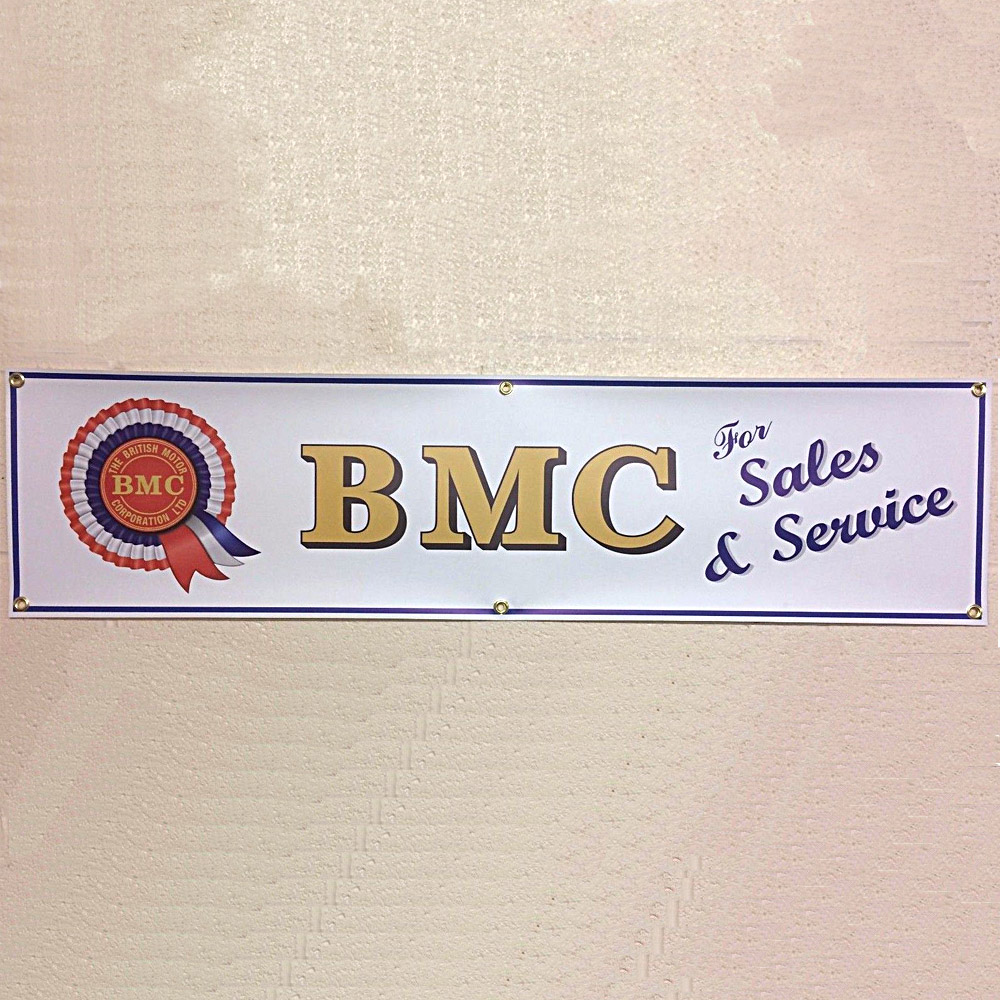 BMC Sales & Service Banner, complete with brass eyelets for wall mounting in a garage or workshop