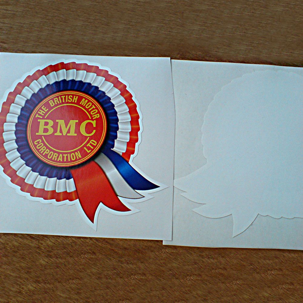 Red, white and blue rosette. BMC The British Motor Corporation Ltd in yellow lettering on red in the centre.
