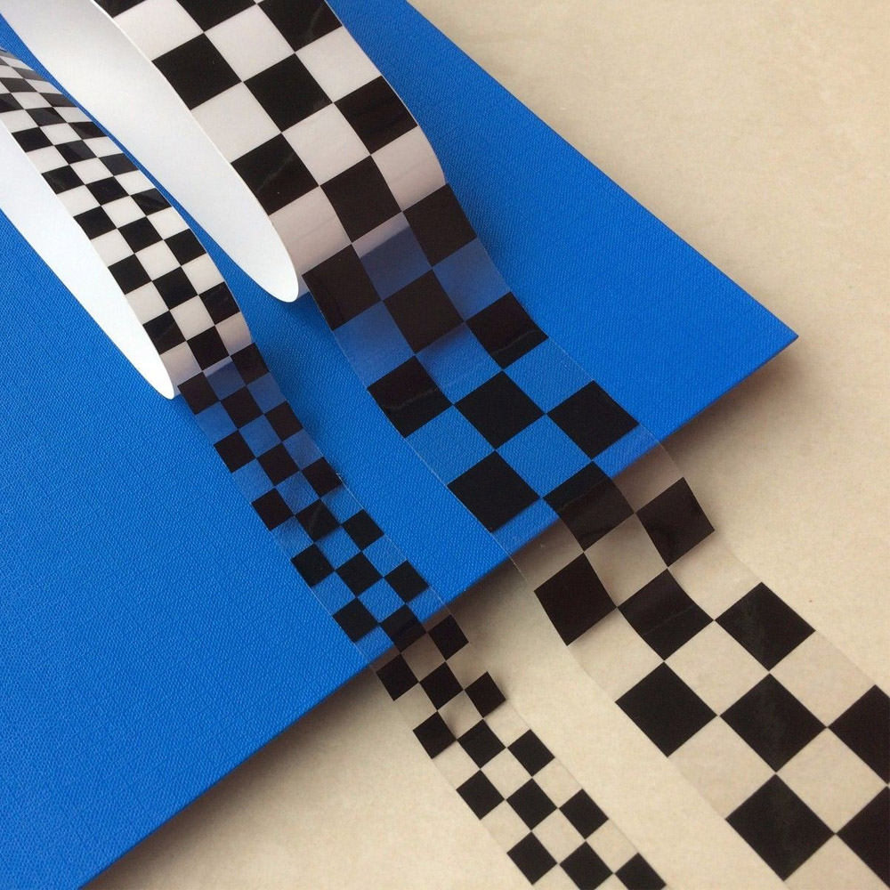 Strip of chequered black and clear tape.