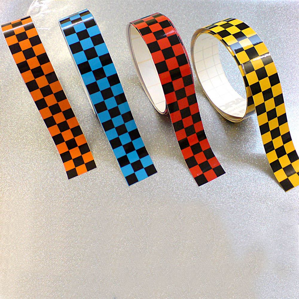 Chequered tape, self adhesive with black and coloured chequers, various colours and widths available.available