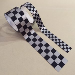 Chequered tape, self adhesive, silver and black chequers. Available in four different widths.